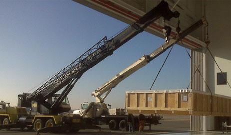 cranes lifting crates